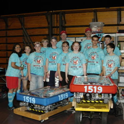 The drive teams and pit crew with both robots.