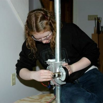Sarah B. checks out the fit of her mini-bot on the pole.