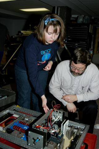 Coach B. and Lizzie P. pondering the electronics layout.