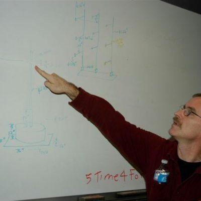 Mr Gray showing diagrams on the whiteboard.
