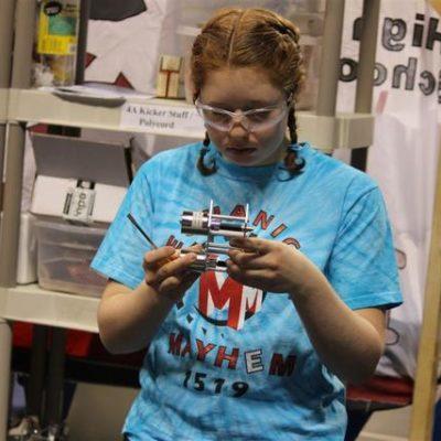 Sarah B. assembling a spare minibot.