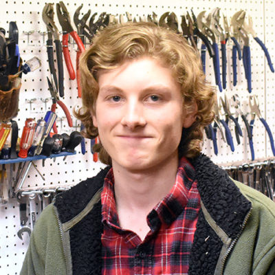 Hi, my name is Cas. This is my third year on the team, and I'm working primarily on the design and building of the robot. In my off time between school and FRC, I typically go mountain biking in places and conditions any sane person would stay away from, such as riding along or down near sheer cliffs while it's -15 degrees and snowing. (and I wonder why people don't want to go on rides with me). I also enjoy woodworking/carving and playing violin.