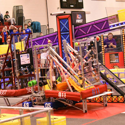 Team 4905 lifts their alliance partners, attaining the first 3-ranking-point match (along with the levitate Power Up earlier in the match)