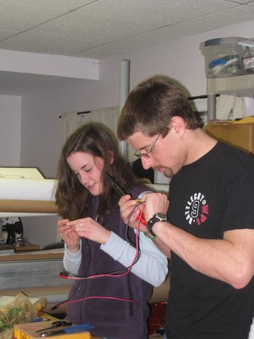 Brittany F. and Nathan S. fixing broken crimps.