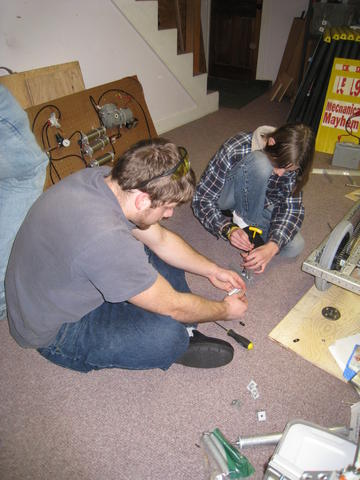 Nathan L. and Justin C. making a prototype out of 80/20.