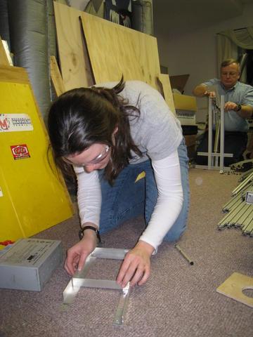 Carissa F. working on a battery box.