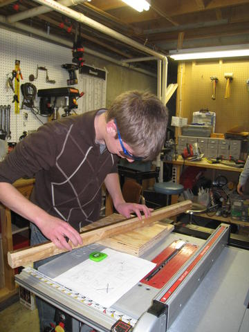 Brendan B. cutting wood for bumps on the table saw.