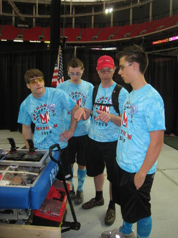 The drive team waiting for a match on the floor of the Georgia Dome.