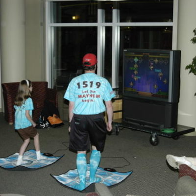 Faith S. and Coach Streeter playing DDR at the Friday night social.
