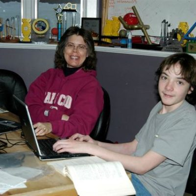 Mrs. Gray and Jackson learning the software.