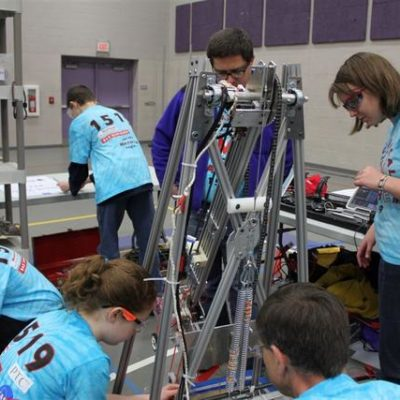 Busily preparing the robot for competition.