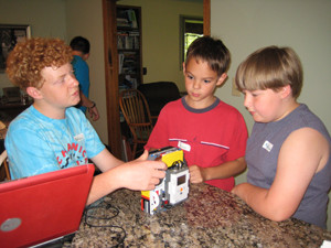 Nathaniel-mentoring-Creepy-Crafters-at-FLL-Camp-2015