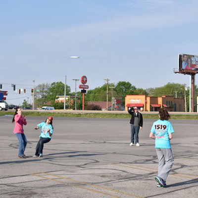 A Frisbee break during the long coach bus trip to St. Louis.
