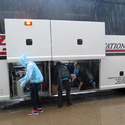 Loading the pit into the coach bus on Saturday in the pouring rain!