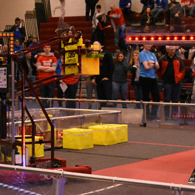 Team 5687 raises cube to the scale